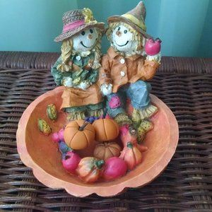 Two Cute  Scarecrows in a Pumpkin Patch